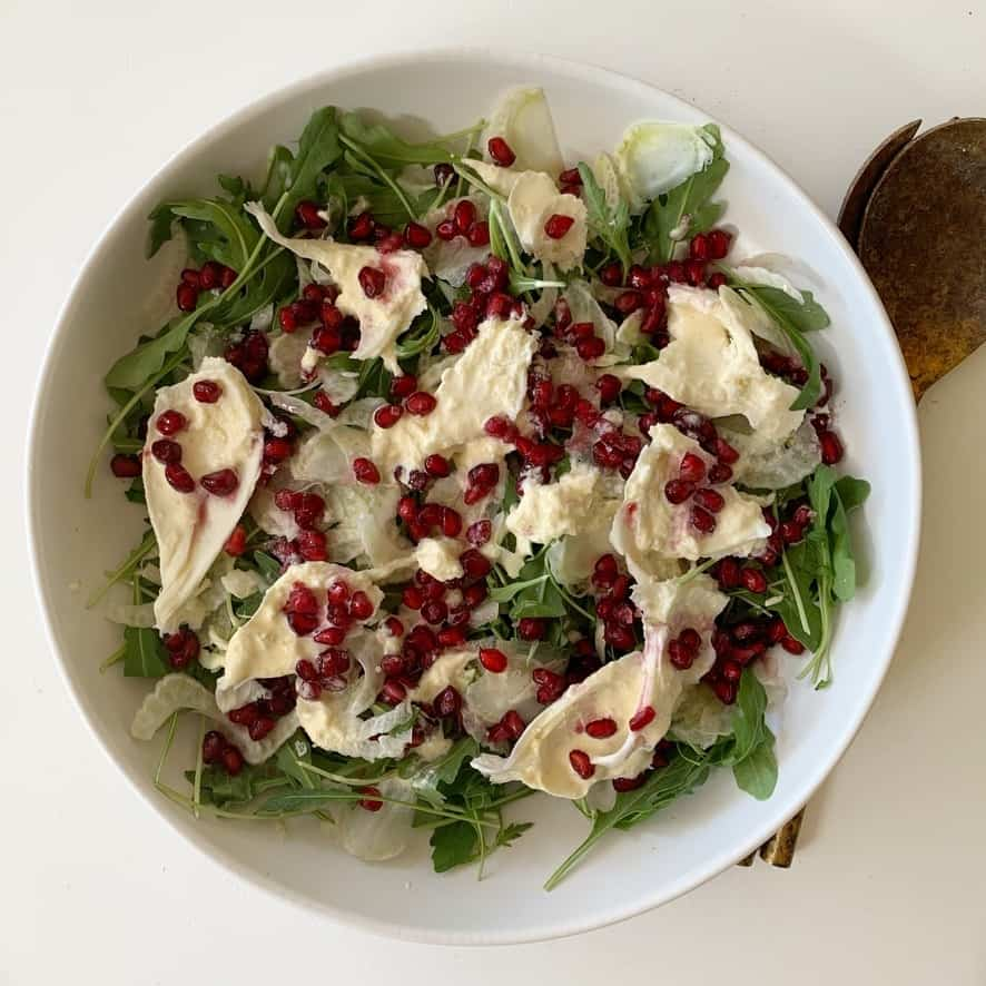 pomegranate and mozzarella salad with greens
